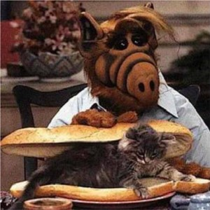 Alf eating a cat
