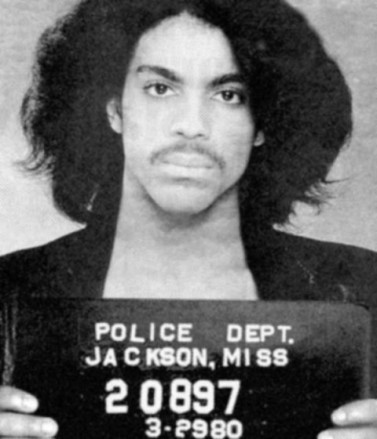 "Yep, that's Prince, arrested for ""pulling a prank"" on an airplane. Didn't do prison time because this was pre-9/11"