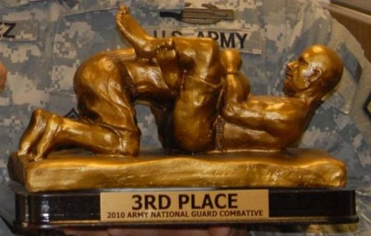 Whoops, that's not the Porn Awards trophy, that's the Army National Guard 3rd Place in Combat trophy. Eh, close enough.